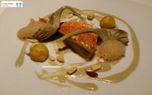 Triglia con carciofo e la sua crema, aria di liquirizia, patate parisienne e tarallo