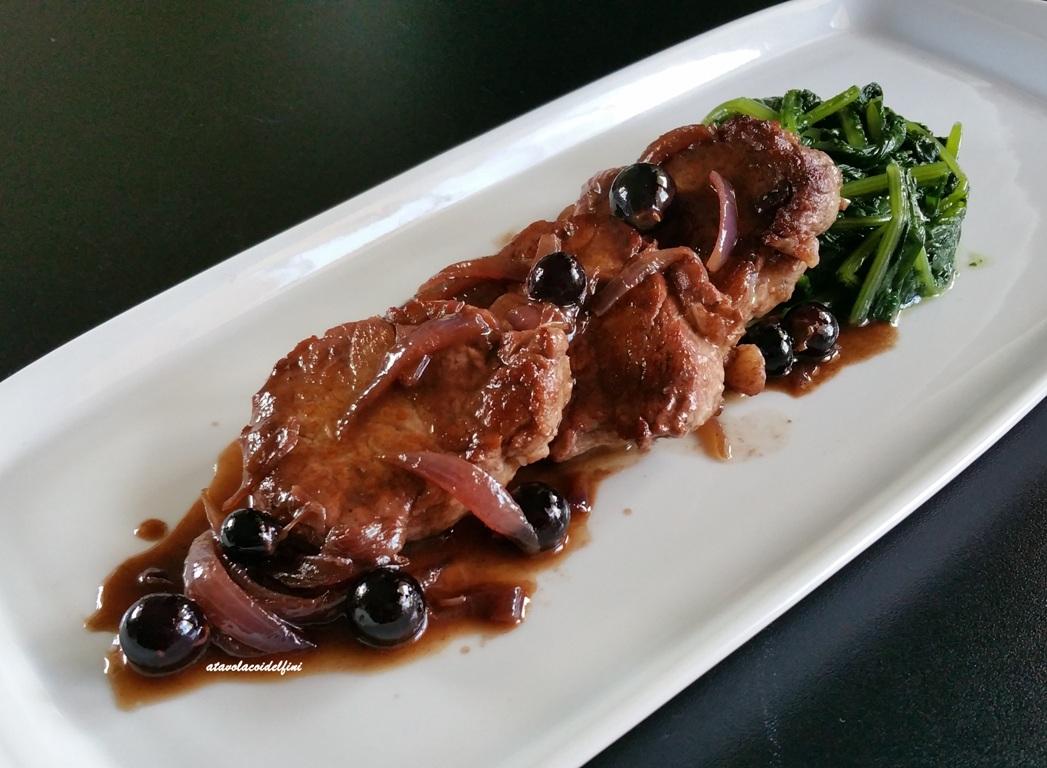 Filetto di maiale nero lucano all'Aglianico del Vulture e i suoi chicchi con cicorie all'aglio