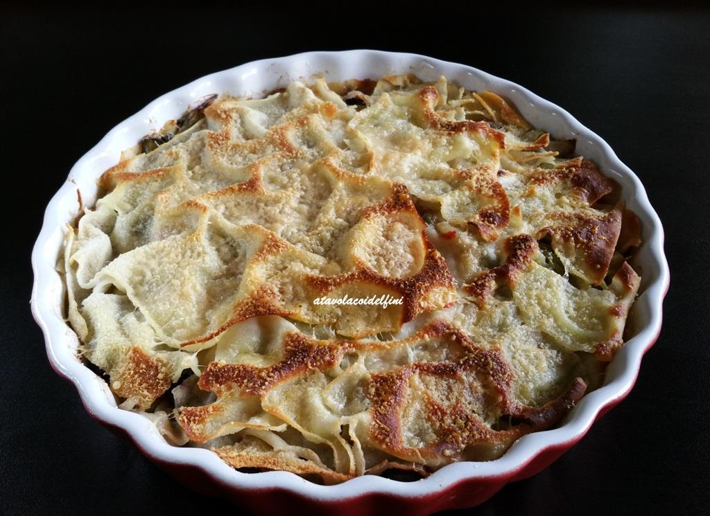 Lasagna di pane guttiau con sponsali, olive celline, speck e pecorino