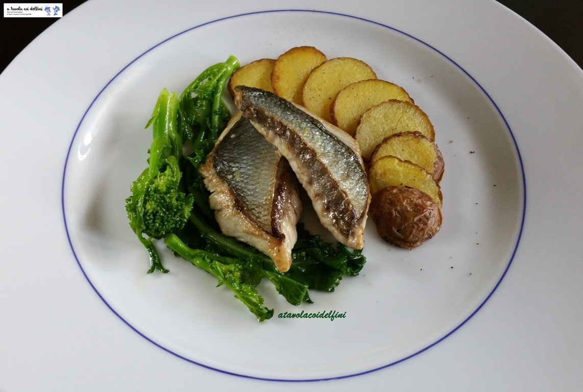 Filetto di pesce serra, patate arrosto e cime di rape all'aglio