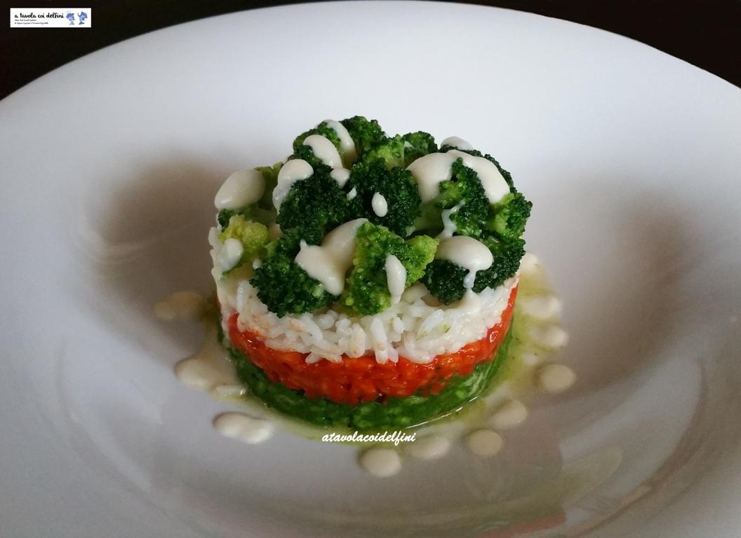 Riso alla crema di broccoli, pomodori e peperoni cruschi con fonduta al parmigiano