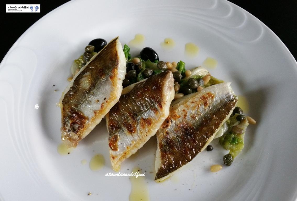 Barracuda arrosto su scarola riccia alle olive celline, capperi e pinoli